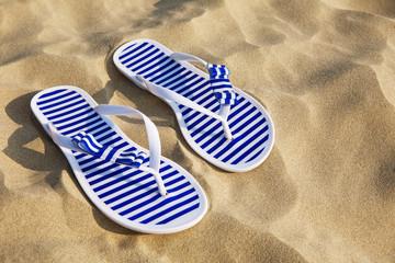 Flip-flops on sand beach