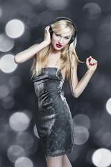 Blonde woman dancing with headphones