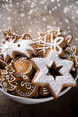 Traditional gingerbread cookies on wooden background