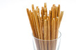 Bread sticks with salt in a glass beaker isolated closeup