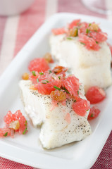 Baked cod with grapefruit salsa selective focus