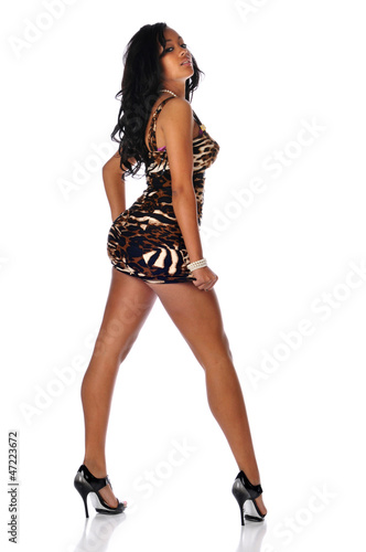 Young Black Woman wearing a short dress