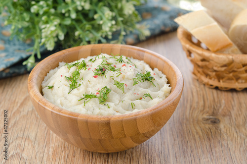 Mashed potatoes and cabbage in a bowl on a wooden table