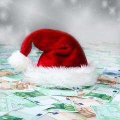 Santa hat lying on bank notes, Christmas money