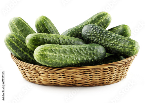 cucumbers in basket isolated
