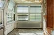 old abandoned house, windows with roller shutter broken