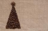 Christmas tree on sack background postcard