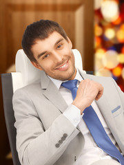 young businessman sitting in chair
