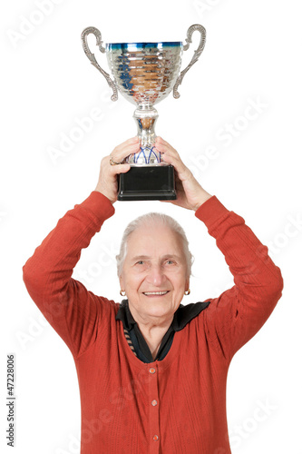 isolated old lady raising trophy on white background