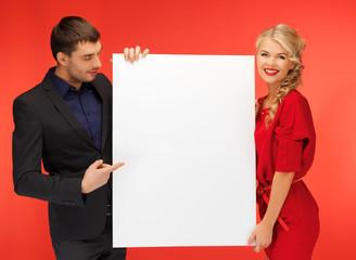 couple holding big blank board