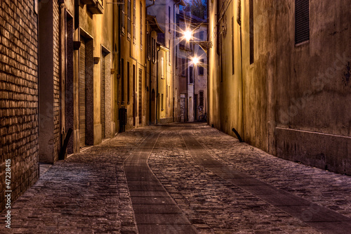 dark alley in the old town 47228415