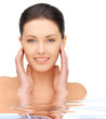 face and hands of beautiful woman in water