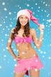 cheerful santa helper girl in lingerie with snow