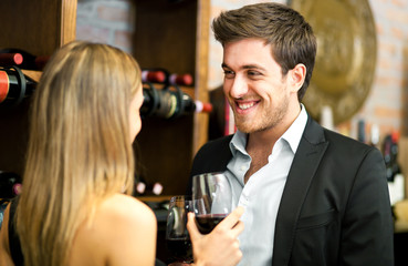 Young couple tasting red wine