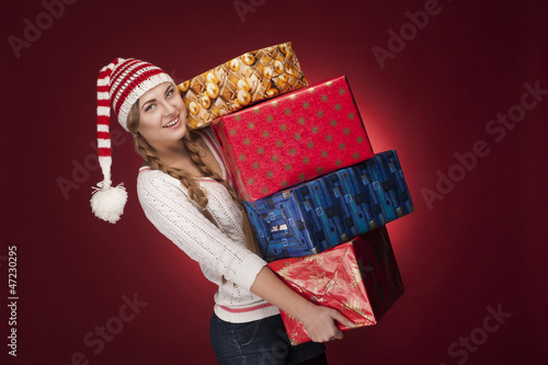 women with Santa hat with presents