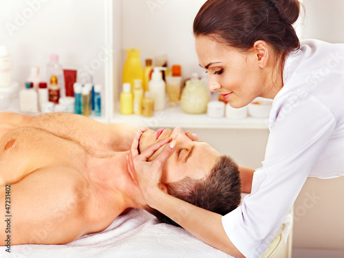 Man getting  facial massage .