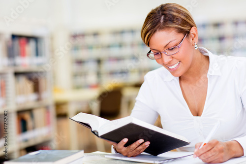 Woman studying at the library
