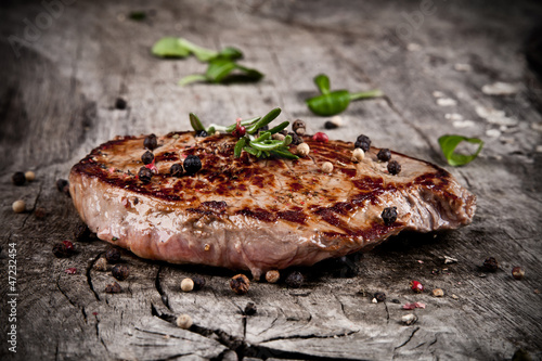 Delicious beef steak on wood