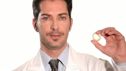 medical doctor holding condom