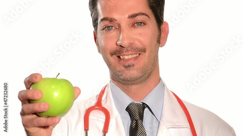 doctor holding a fresh green apple