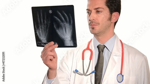 doctor looking to x-ray