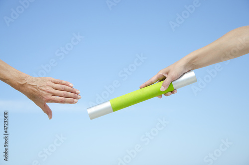 Isolated athletes hands with baton