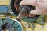 checking bearing on rotor shaft poster
