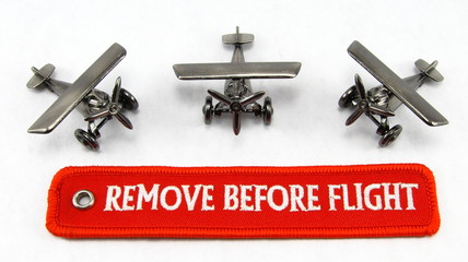 Remove before flight streamer and toy airplanes
