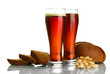 two glasses of kvass and rye breads with ears, isolated on