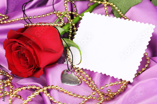 Heart pendant with red rose
