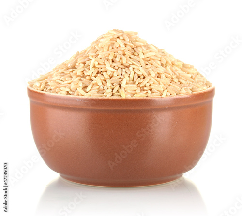 brown rice in a brown plate , isolated on white