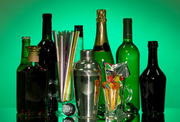 Collection of drinks, cocktail shaker and  other bartender