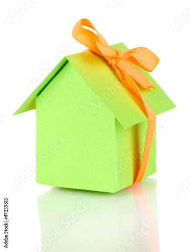 Small house with ribbon isolated on white
