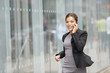 Business woman busy on mobile phone running