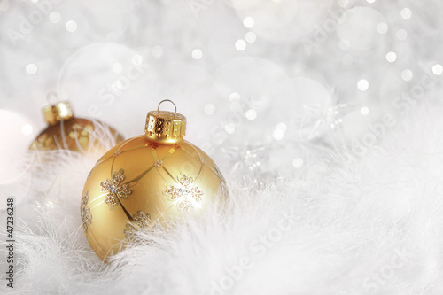 Golden Christmas balls on holiday background