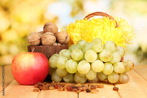 Grape with nuts on wooden table