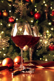 Glasses of wine in front of Christmas tree
