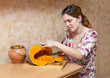 young woman cooking pumpkin