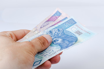 Polish zloty banknote held in hand