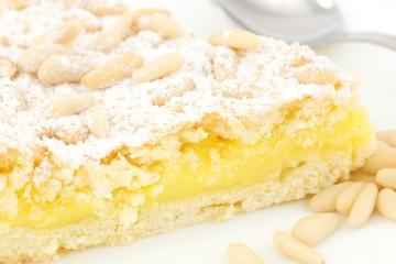 Grandma's cake, with cream and pine nuts