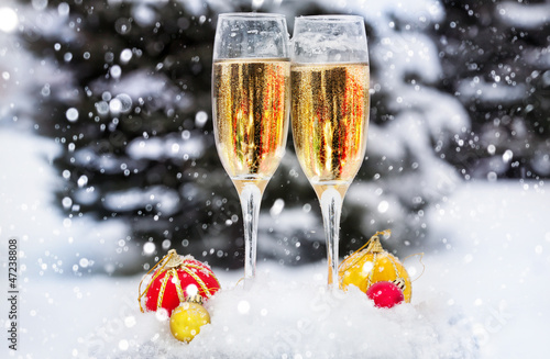 Two glasses with champagne on the snow