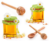 Honey dipper and Honey in glass jar isolated on white