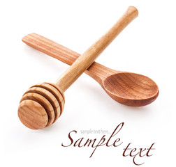 Wooden honey dipper and spoon isolated on white background
