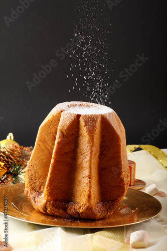Pandoro Christmas cake on decorated table