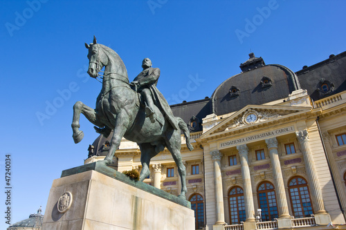 King Carol I statue with Bucharest Central University Library
