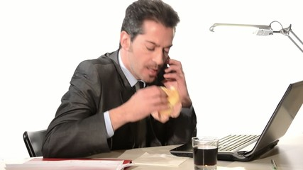 businessman with phone eating unhealthy food