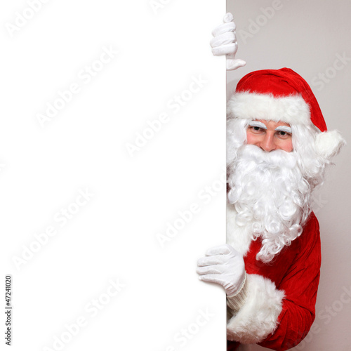 Santa schaut um die Ecke