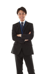young businessman with his arms folded