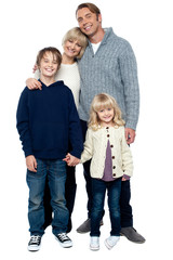 Cheerfully winter wear family of four. Stay protected