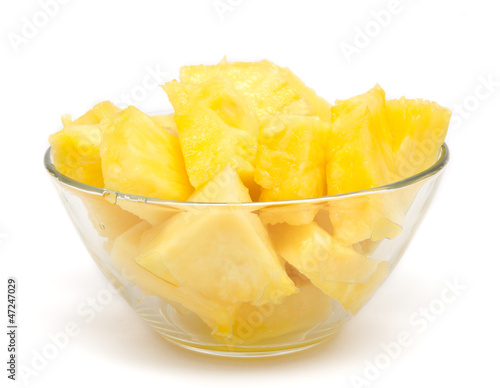 Pineapple chunks in the bowl isolated